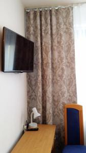 Telewizja i/lub zestaw kina domowego w obiekcie Hotel As
