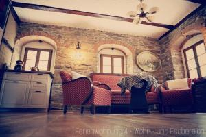 Ein Sitzbereich in der Unterkunft Apartment Grubenhaus20