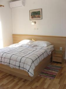A bed or beds in a room at Apartmani Milka