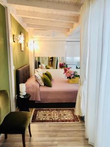 Letto o letti in una camera di Dimora Umberto Home - Piazza Cavour