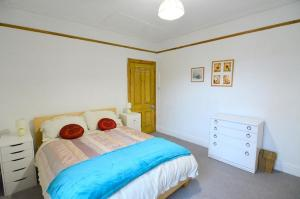 A bed or beds in a room at Grace Place