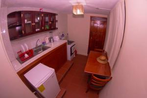 A kitchen or kitchenette at Samay Apart