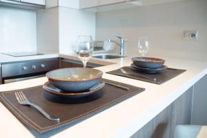 A cozinha ou cozinha compacta de Arauco Studio Apartment