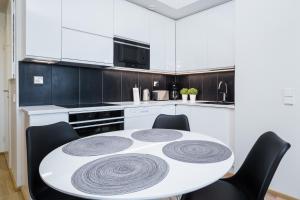 Majoituspaikan JHO Premium Apartments keittiö tai keittotila