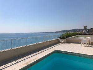 The swimming pool at or close to Apart-a-Nice : A Breathtaking View on the Sea