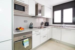 A kitchen or kitchenette at Heart of Sitges