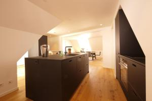 A kitchen or kitchenette at Rent a Place 5