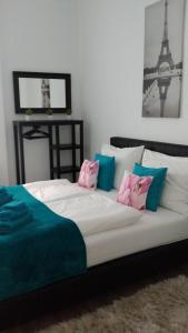 Ein Bett oder Betten in einem Zimmer der Unterkunft Palace Residence