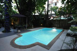 The swimming pool at or near Siam Palm Residence