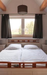 Ένα ή περισσότερα κρεβάτια σε δωμάτιο στο Ferienhaus am Alfsee