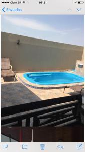 The swimming pool at or near Sua casa fora de casa