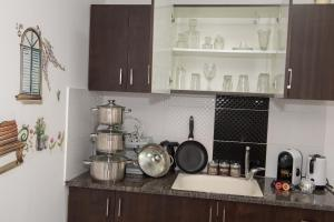 A kitchen or kitchenette at Sweet Dreams Apartment