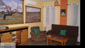 Zona de estar de Apartamentos Estrellas de Monfragüe