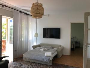 Postelja oz. postelje v sobi nastanitve Vila Platana