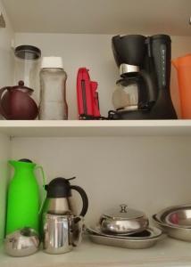A cozinha ou cozinha compacta de Flat Novo, Confortável e Aconchegante!