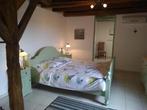 Un ou plusieurs lits dans un hébergement de l'établissement Le Domaine du Chasselas La Grappe