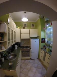 A kitchen or kitchenette at Apartamenty Sopot Centrum
