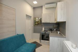 A kitchen or kitchenette at Il Mondo Apartments