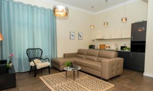 A seating area at Apartament Maximum