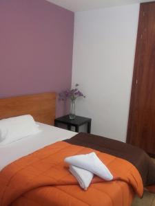 A bed or beds in a room at Apartamentos Puerta Real