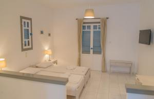 A bed or beds in a room at Ostria Hotel & Apartments