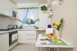 A kitchen or kitchenette at Exotic Rami's Apartments