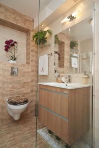 A bathroom at Exotic Rami's Apartments