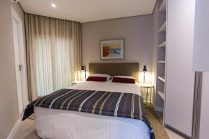 Cama ou camas em um quarto em Residencial Estanconfor Santos