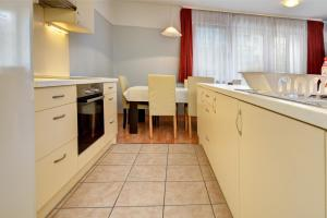 A kitchen or kitchenette at Agape Apartments