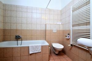 A bathroom at Agape Apartments