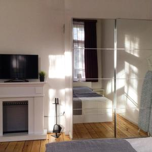 A television and/or entertainment center at Apartment August 11