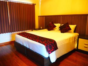 A bed or beds in a room at Juada Garden