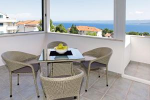 Un balcón o terraza de Apartments Mel