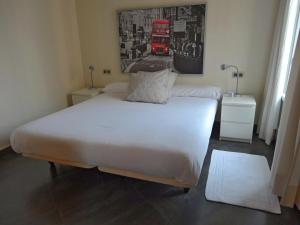 A bed or beds in a room at Roomspace Sandoval