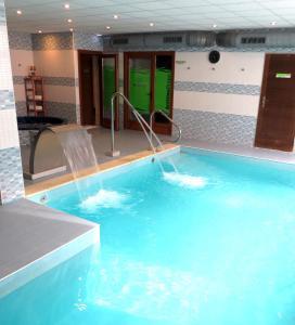 The swimming pool at or near Apartamentos Rurales & Spa Antilles Playa