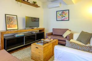 A seating area at Apartamento recém reformado e bem decorado