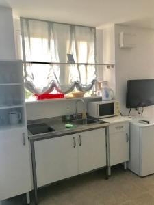 Kuhinja ili čajna kuhinja u objektu Villa Viden Apartment 01