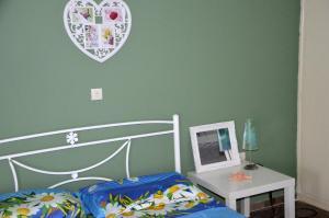 Ένα ή περισσότερα κρεβάτια σε δωμάτιο στο Blue Green Studio
