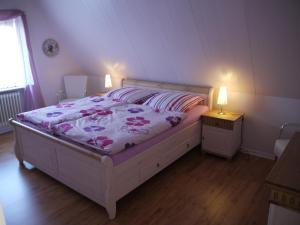 Łóżko lub łóżka w pokoju w obiekcie Ferienwohnungen Stoldt