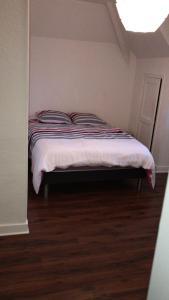 Un ou plusieurs lits dans un hébergement de l'établissement Appartement coeur de ville