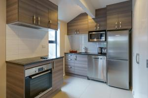 A kitchen or kitchenette at Apartments 118