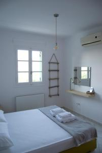 A bed or beds in a room at Naxos olive & home