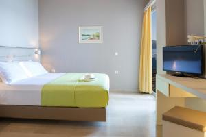 A bed or beds in a room at Adriatica Hotel