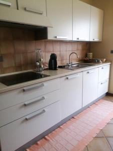 A kitchen or kitchenette at Modern center apartment