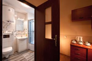 Vonios kambarys apgyvendinimo įstaigoje Station Aparthotel