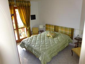 A bed or beds in a room at Casa del Mare