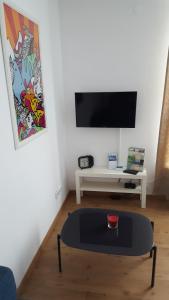 TV/Unterhaltungsangebot in der Unterkunft Apartment Nähe Rathaus