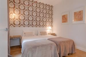 A bed or beds in a room at Look Barcelona Apartment