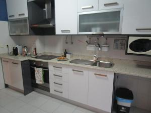 A kitchen or kitchenette at Casa das Âncoras