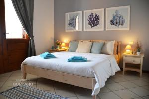 A bed or beds in a room at BookingBoavista - Apartments